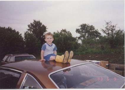 dk as kid on car